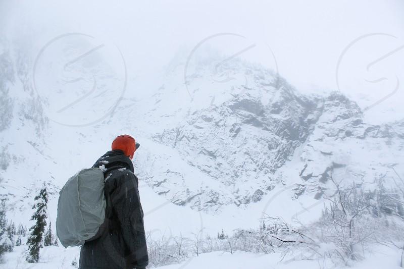 man hiking snowy mountain photo