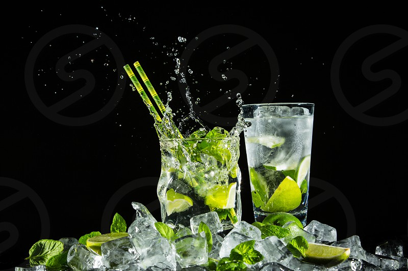 Mojito on ice. Studio photo on a one-color background. photo