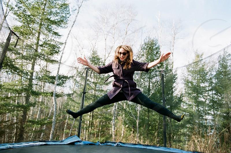 Woman trampoline vacation photo