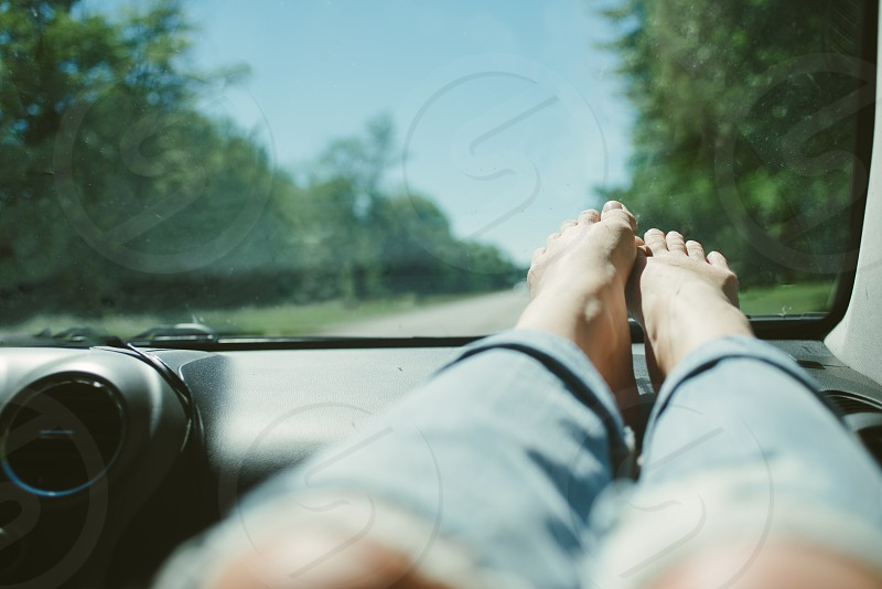 Feet on the dashboard during a summer road trip photo
