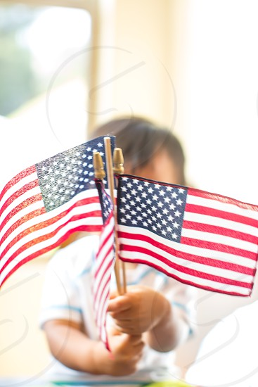 Child celebrating with American Flag photo