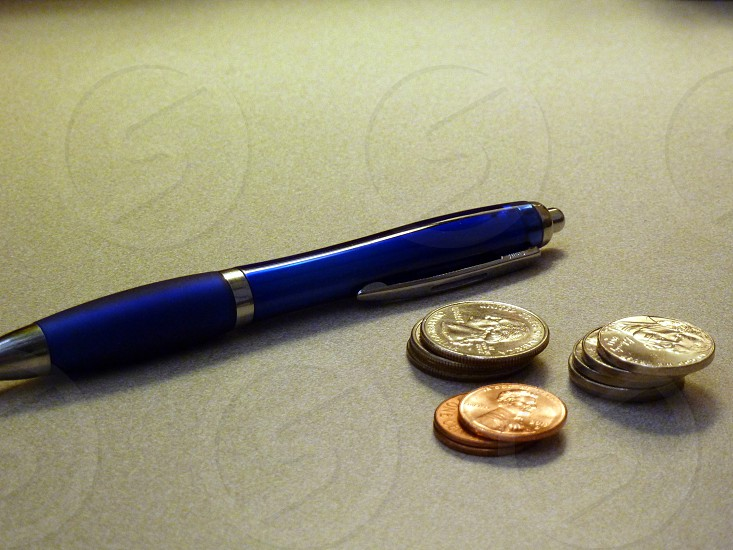 pen and coins photo