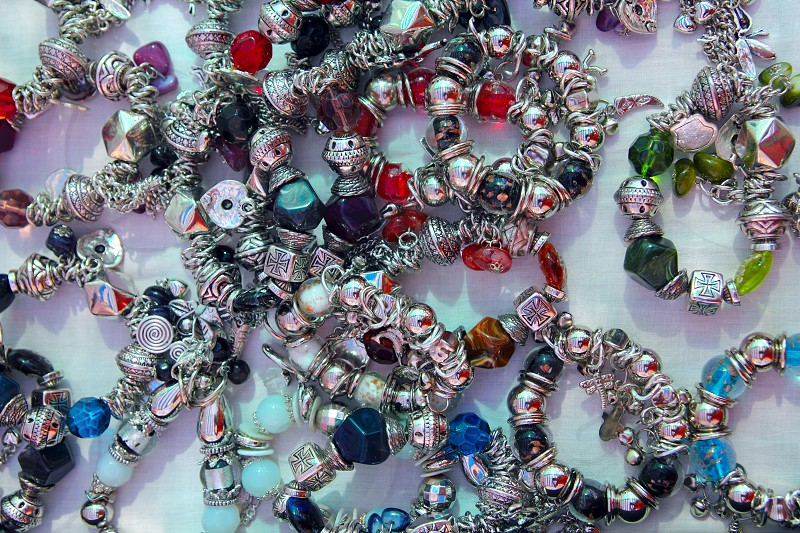 silver jewellery blacelets shop display colorful stones photo