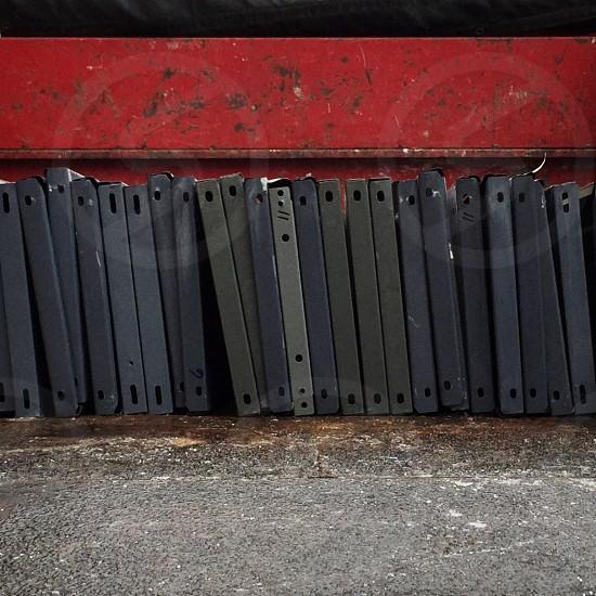 black binders piled arrange on floor photo