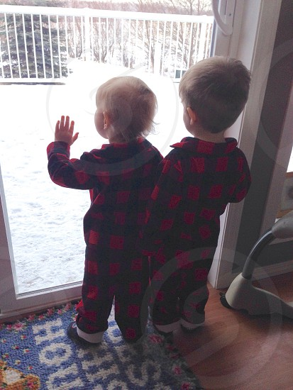 Matching cousins at the window photo