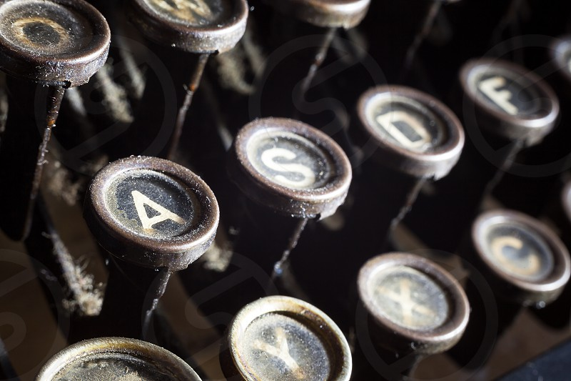 Details of an old retro typewriter vintage style dusty surfaces.  photo