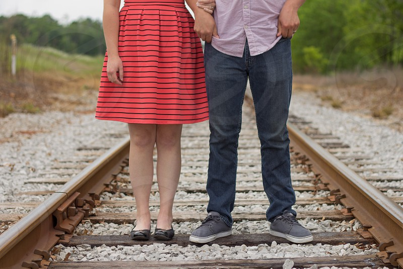 Couple together on Railroad Tracks photo