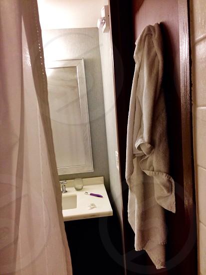white bath towel hanged photo