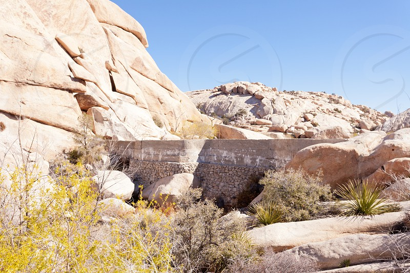 Barker Dam concrete vintage Mojave Desert ranching infrastructure for watering cattle in Joshua Tree National Park California CA USA photo