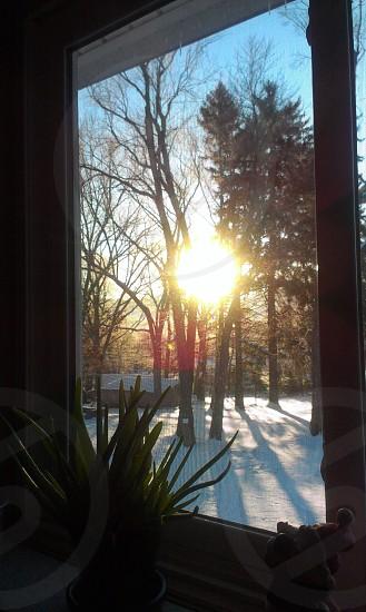 Early morning sunrise through a window photo