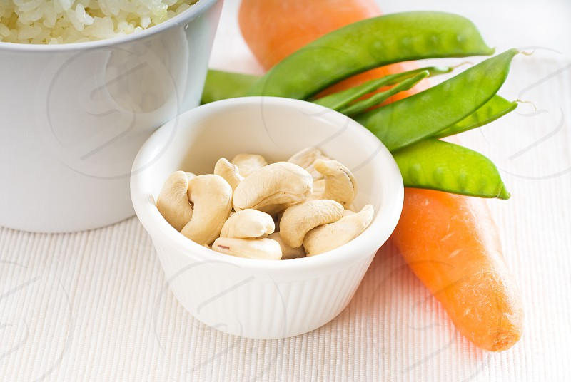 fresh cashew nut and vegetableswith steamed white rice typical ingredients of chinese cuisine photo