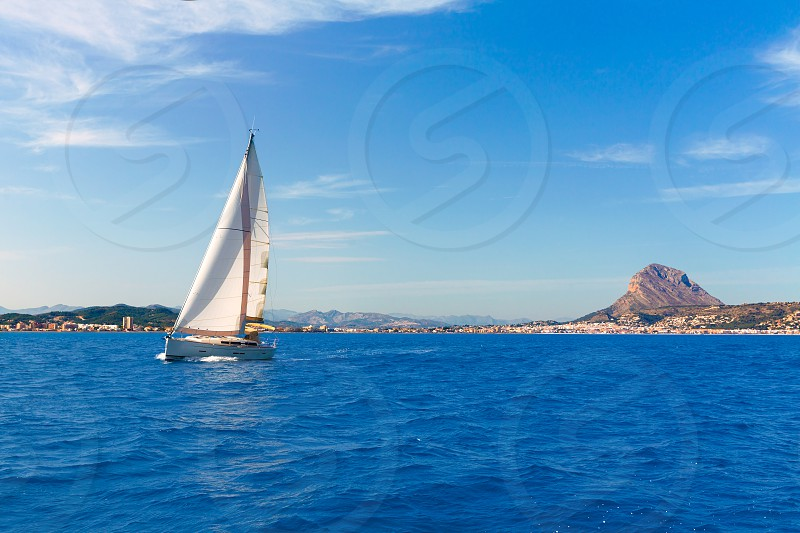 Javea sailboat sailing in Xabia at Mediterranean Alicante of Spain photo