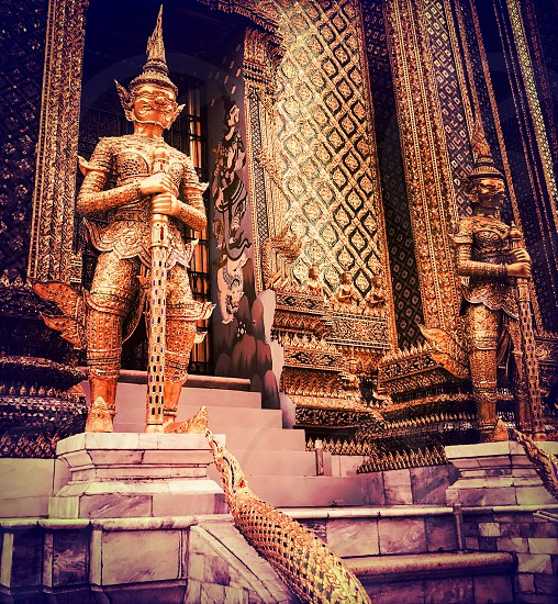 Outdoor day colour Grand Palace Bangkok Thailand Kingdom temple shrine monument Buddhist Buddhism holy religious religion royal regal king east eastern Far East travel tourism tourist wanderlust mosaic tile decor decoration elaborate ornate gold emerald gold leaf architecture statue square photo