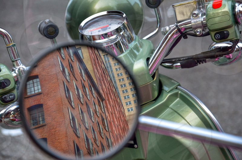 green motorcycle side mirror photo