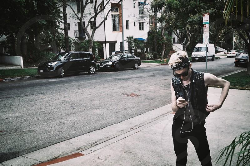 Punk Youth technology leather jacket blonde hair rebel bad one guy bandana biker street photo