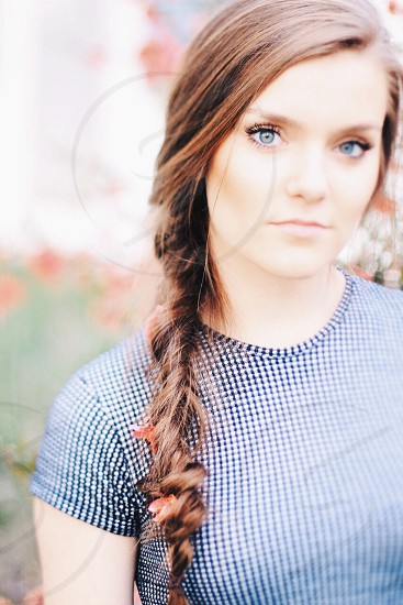 woman in blue and white checked shirt with a braid photo