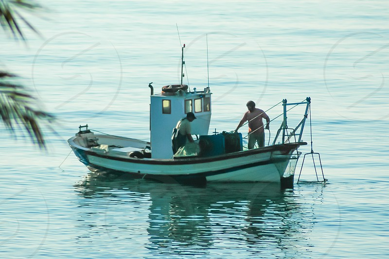 Traditional fishing boat in the Mediterranean sea Spain photo