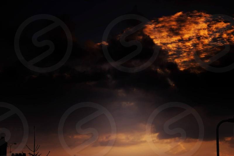 Sky. Storm. Red sky. Sunset. Sunrise. Orange sky. Silhouette.  photo