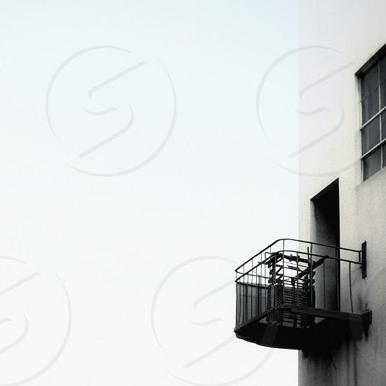 black metal fire escape on white building photo