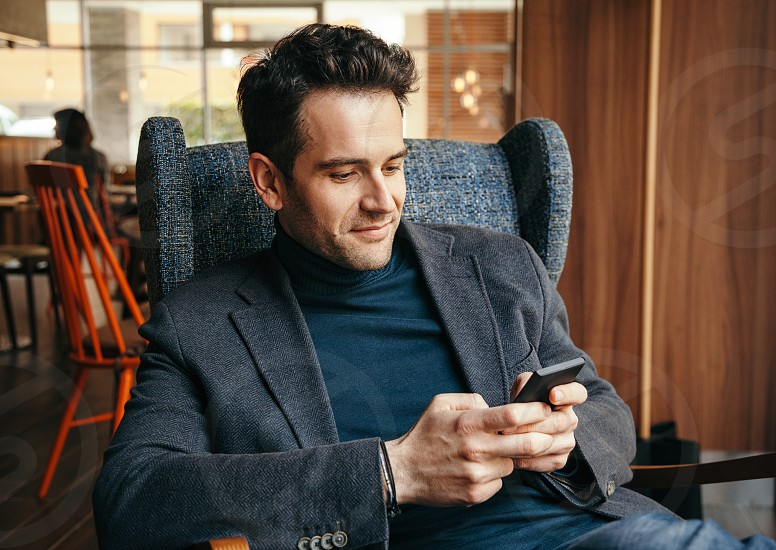 Young businessman texting on a smartphone photo