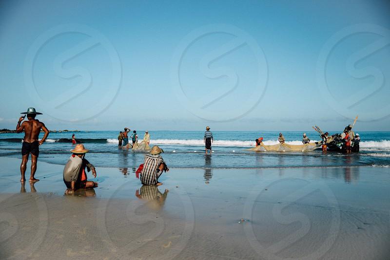fiserhmen fishing water sea ocean boat net men hats asia asian myanmar burma beach sand water blue photo