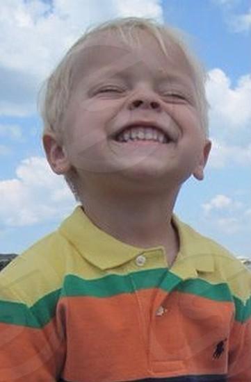 smiling blond boy photo