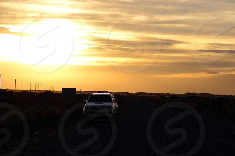 van parked on rural road at sunset photo