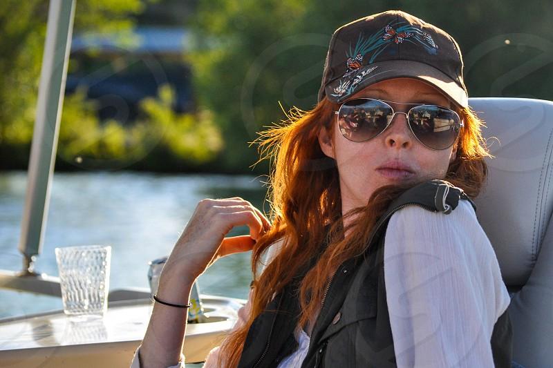 Millennial redhead trucker hat boat sunglasses photo