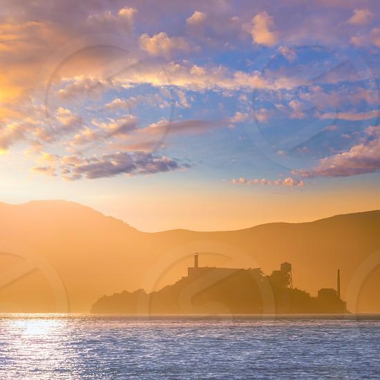 Alcatraz island penitentiary at sunset backlight in san Francisco California USA photo