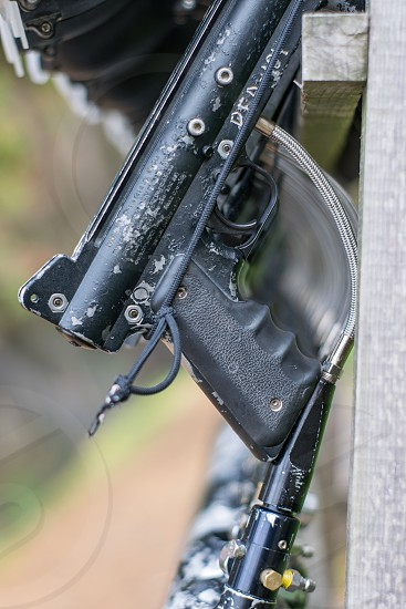 Close up shot of paintball gun handle. Paintball ammunition. photo