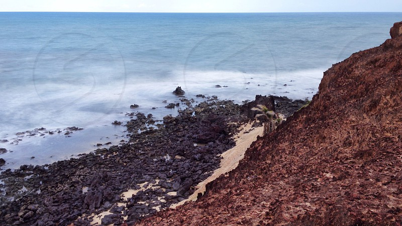 brown rock near water photo