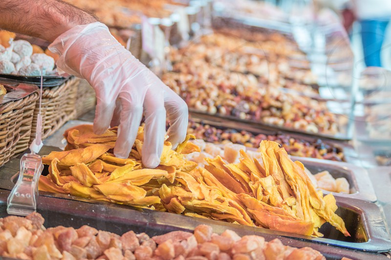 French market stall selling candied fruits and roasted nuts photo