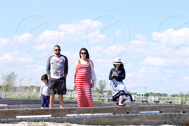 family standing on wooden planks photo
