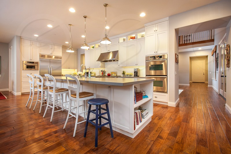Beautiful custom contemporary residential kitchen. Island White Stainless Seating Wood Colorful Open.  photo