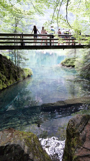 People on a bridge  Blausee Switzerland photo