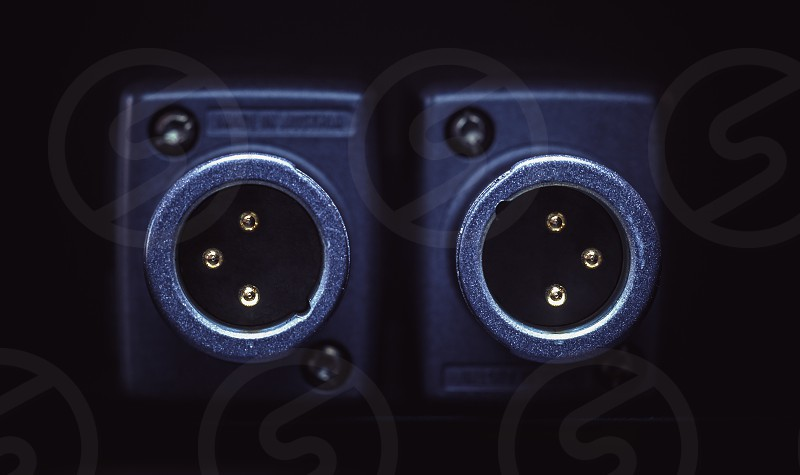 Closeup view on microphone xlr gold plated connectors.  photo