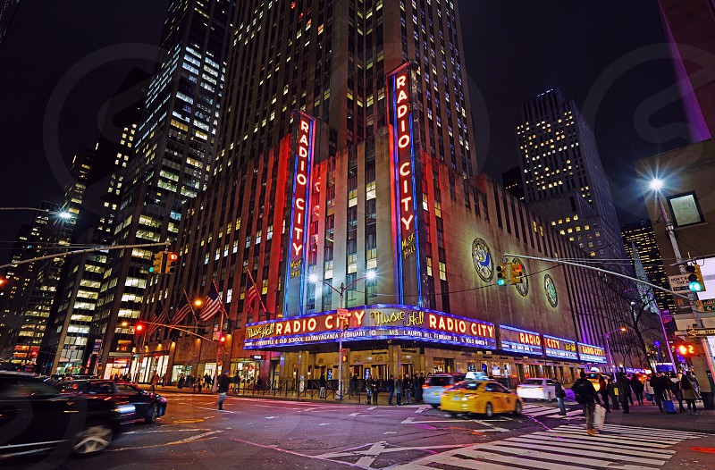 Night view of Radio City Music Hall in New York City photo