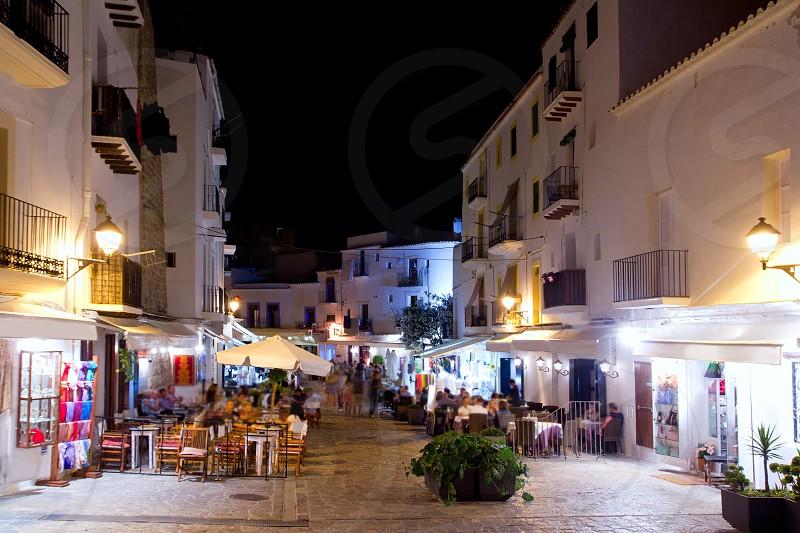 Ibiza dalt vila nightlife under night lights and white houses photo