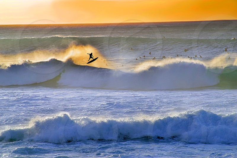 A surfer escapes a wave at Banzai Pipeline on the North Shore Oahu Hawaii. photo