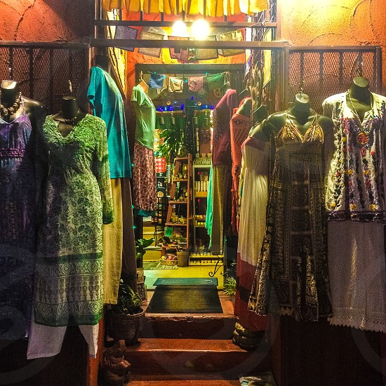 assorted color dress store for women during nighttime photo