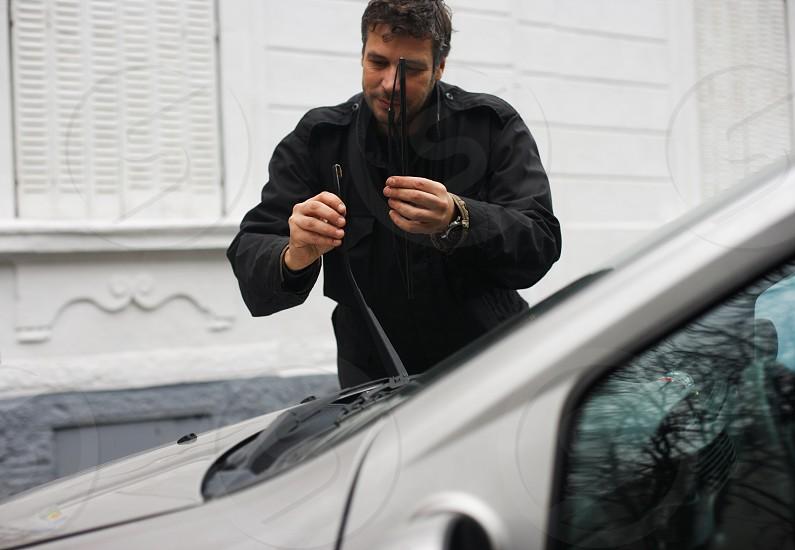 Man changing wiper blades photo