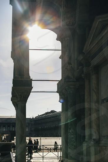 sun flare venice st marks square italy square building columns sunset glare saint mark's marks square piazza photo