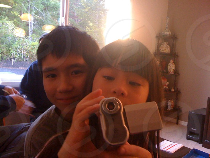 girl holding grey video camera photo