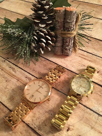 2 gold link chain link bracelet round watch on brown wooden table photo