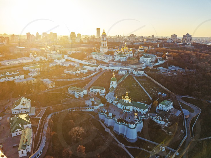 Panoramic view from the drone to the Kiev Pechersk Lavra with numerous architectural monuments at sunset in the summer. Panoramic photography from the drone. photo