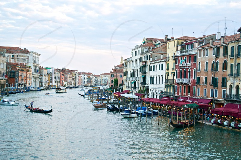 gondola on the water surrounded by different color house photo