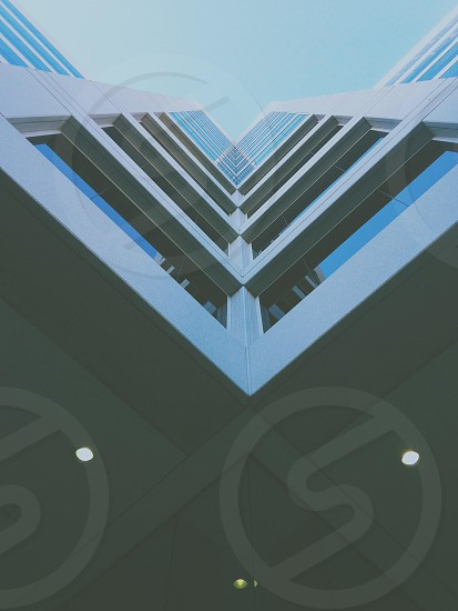 clear glass walled high rise building on architectural photography photo