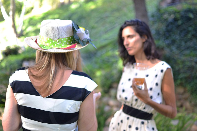 view of woman wearing black and white stripe blouse with hat photo