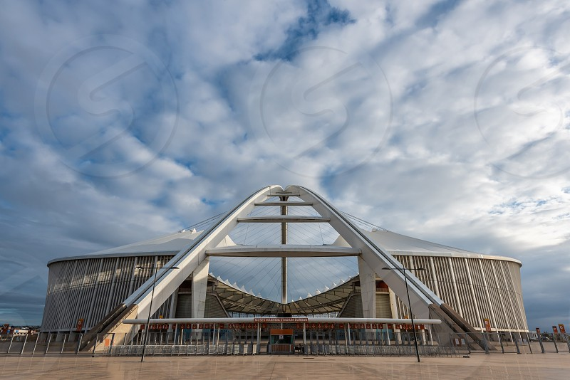 The elegant and inspiring Moses Mabhida Stadium in Durban South Africa.  The stadium was designed by architect Gerhard le Roux and was completed in 2009. photo