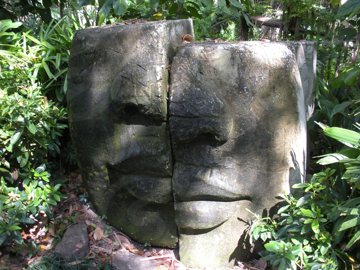 Rock stone statue in the jungle. photo